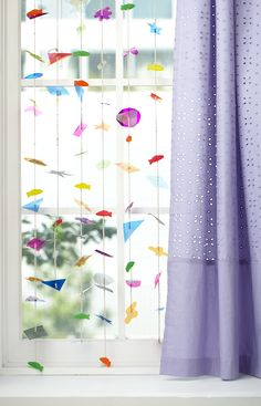 http://blog.landofnod.com/honest-to-nod/2011/12/try-this-colored-cellophane-garland-curtain.html