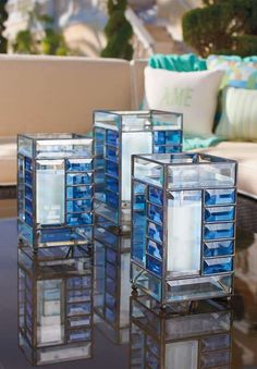 The Contempo Luminary Lantern shines  a soft glow on your outdoor space while offering modern style and beautiful hues of blue.