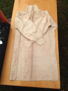 """An overall look at a c. 1790s to early 1800s shirt that is in great condition. It is made of unbleached linen with salvage edges sewn together only along the side that is folded over. This shirt is in the private collection of Tony Holbrook who says """"it is a learning tool"""". This shirt was purchased off Ebay from a woman in the United States but the shirt has no provenance. — with Tony Holbrook at Department of the Geographer to the Army, 1777-1783."""