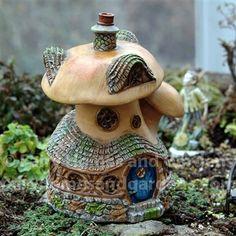 Fiddlehead Fairy Mushroom Cottage at http://www.fairyhomesandgardens.com