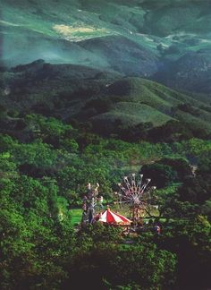 Forest Carnival in the hills of Romania.  mountains, Ferris wheel, play, kids, green, mechanical, out of place, odd, beautiful