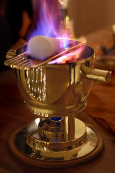 Feuerzangenbowle, Germany. a traditional German alcoholic drink for which a rum-soaked sugarloaf is set on fire and drips into mulled wine. It is often part of a Christmas or New Year's Eve tradition. The name translates literally to fire-tongs punch.