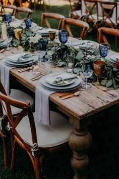 : Modern Romantic Saddlerock Ranch Wedding in Shades of Dusty Blue This rustic tablescape features blue decor, greenery, and gold accents Wedding Reception Tables, Wedding Table Centerpieces, Flower Centerpieces, Table Decorations, Centerpiece Ideas, Church Wedding, Wedding Planning Notebook, Dusty Blue Weddings, Blue Rustic Weddings