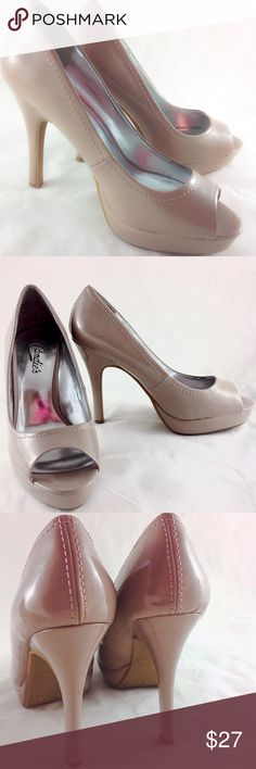 """Candie's Peep Toe Pumps Basically Perfect! Worn once for a couple of hours. EUC.  Candie's gorgeous dark cream color peep toe pumps.  Size 8 with 4"""" heels. Please ask all your questions before you purchase! I am happy to help! Sorry, no trades or holds. Please, no lowball offers Please use Offer Button! Happy Poshing! Candie's Shoes Heels"""