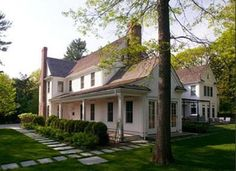 New, but made to look antique, home by architect D. Michael Collins... Take that Suburbia!