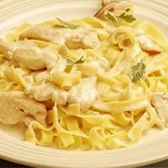 This is a rich and creamy Alfredo sauce of butter, ricotta cheese, cream and Parmesan cheese. It's served with fettuccini and sauteed chicken.