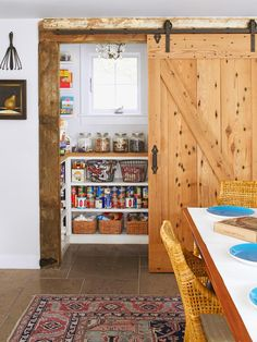 Gorgeous pantry with sliding barn door built from reclaimed pine.
