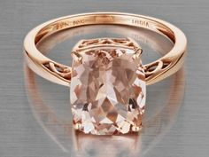 Morganite set in rose gold with filigree side shoulders & basket. Perfect colors that would compliment warm skin tones!