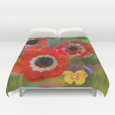 Red anemones in a summer garden Duvet Cover