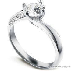Absolutely stunning. This twist engagement ring has inclined diamond set shoulders with grain setting.