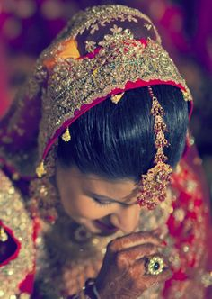 Indian Bride and her enchanting head gear.