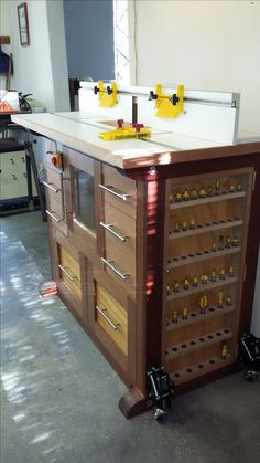 This is a beautiful router table with the traditional bench styling and color choices.  I'd love to see what the bit storage door is hiding.