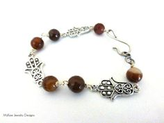White and brown agate faceted banded gemstone, silver Hand of Fatima Charms bracelet. McKee Jewelry Designs