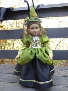 Our concession to Halloween--the doll's green eyes go great with the costume, so we are offering her with the outfit, as an option.  Crow's feathers, spiders, broomstick (see next photo), the lot!
