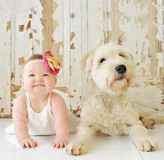 A baby and a goldendoodle dog...adorable.