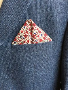 For debonair grooms wanting to add a bit more color to their wedding suit, a pocket square is a great way to add personality and flair. Keep it classic with a solid color or use a pretty pattern like this sweet floral for the occasion.