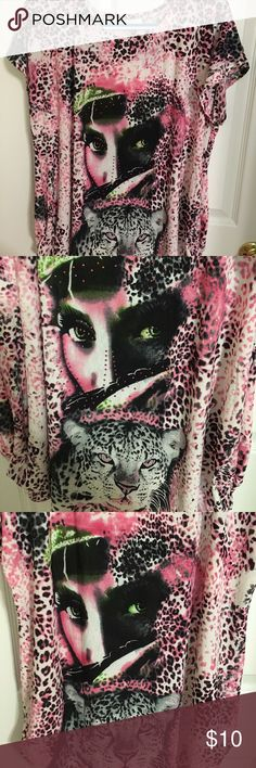 Ladies Shirt Ladies pink leopard shirt with ladies face and tiger. Stone work around ladies head. Fabric 65% silk and 35% polyester. New never worn. Size XL Tops Tunics