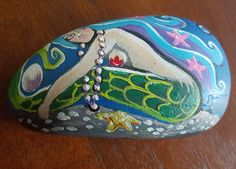 Painted rock, mermaid at rest