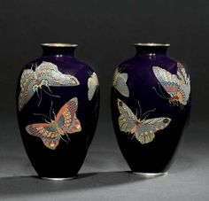 A PAIR OF CLOISONNÉ VASES SIGNED AICHI HAYASHI KO, MEIJI PERIOD (LATE 19TH CENTURY) Worked in various thicknesses of silver wire and coloured cloisonné enamels on a dark blue ground with butterflies and moths, silver mounts