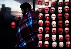 A homeless man in São Paulo walks past masks depicting the faces of politicians during a protest against political corruption by nongovernmental organization Rio de Paz. NACHO DOCE/REUTERS