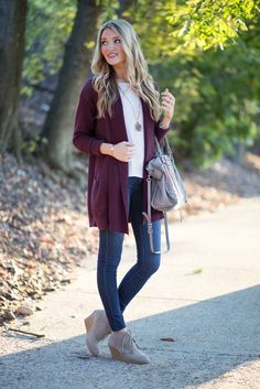 jeans, wedges, a purple cardigan and a white t shirt