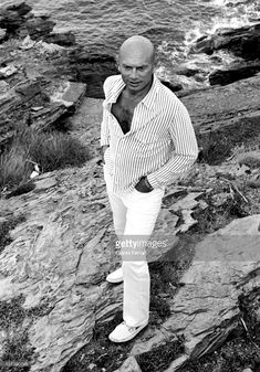 News Photo : Yul Brynner with a dog on the Catalan coast...