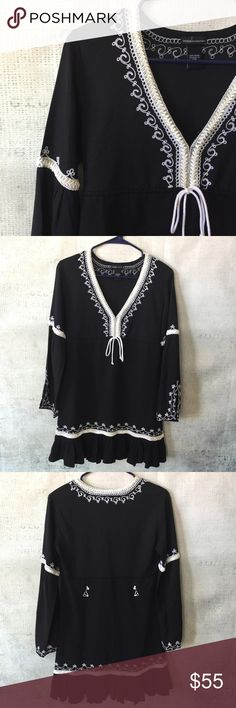 MODA International Black Embroidered Tunic Dress This Tunic dress is perfect for spring/summer. Easy to dress up or down! Boho gypsy look. New w/o tags!!   Embroidered ruffle hem dress. Empire waist with adjustable tie that can be cinched in to adjust fit.   To ensure proper fit, please review measurements. Please note, measurements are in inches, taken flat and are approximate (double where appropriate):     Length (Shoulder to hem) :     33  Bust (Armpit to armpit):    18  Waist: 15…