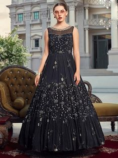 Subtle black embroidered gown online at best shopping price. Shop this latest gown style for diwali celebration. This alluring style set comprises a silk gown with matching net dupatta.
