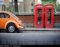 Orange Wolsvagen and two traditional phone boxes in Wardour Street, close to Piccadily Circus, Central London, England, U.K. © Lluís Real / age fotostock