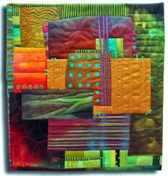 """Fibermania: Golden Stack Hand dyed cottons, silk dupionni, and commercial cottons, batiks, fused, hand and machine quilted, 17.5"""" x 19.25""""."""