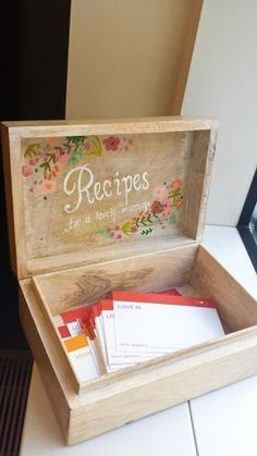 "DIY a cute recipe box (like this one from Strawberry Milk Events) for a ""guest book"" and ask the bride's friends and family to jot down some words of wisdom for what makes a happy marriage. Or, if the bride loves to cook and bake, have everyone bring favorite family recipes to add to the box."