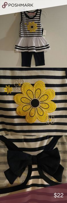 Baby tunic & leggings Kids Headquarters white & navy top with navy leggings (knit). Size 18 months. Top is  striped with a yellow flower applique in front (knit) and ruffle with navy trim (woven). Racer back with a navy bow. Cotton/polyester. Kids Headquarters Matching Sets