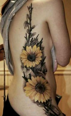Single sunflower on the back of my neck above my other one with it all combining together for one awesome piece.