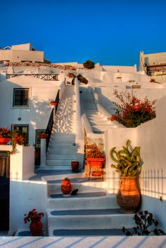 Sunset Steps in Oia, Santorini My dream came true...walked these steps last summer and it was absolutely beautiful!