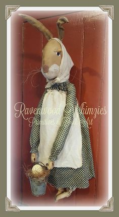 My newest Prim bunny - all dressed up for Easter! Beatrice is a big girl at 22 long NOT including her wired ears. She is made of double stained muslin, with hand-painted eyes. She wears a checkered calico dress, and stained muslin bloomers, apron and kerchief. She carries a rusty