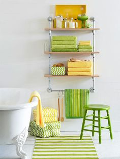 Love the colors!  Essentials Close at Hand.  Plumbing Shelves. Get bulky towels out of overstuffed closets and store them right in the bathroom. This galvanized-plumber-pipe shelving offers an industrial vibe and allows color and personality to shine in an otherwise simple bathroom.