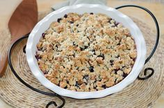 Paleo Peach Blueberry Crisp. Modified (Halved: 1/3 c gf baking mix, 1/2 c oats, 1/3 c prunes, 1/8 c coconut oil, squirt of honey, sprinkling of sesame and pumpkin seeds - grind in food processor, sprinkle over peaches, bake at 350 for 30 min.)