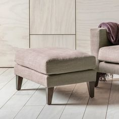 Shoreditch Footstool  The Shoreditch, with its washed cotton fabrics and subtle hues, is a perfect addition to the modern home.  The elegant tapered legs give each model an elegant stance to match the superior comfort.