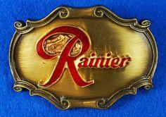 Vintage 1980 RAINIER BEER Heavy Metal Belt Buckle Red Enamel Lettering  eBay Link: http://www.ebay.com/itm/Vintage-1980-RAINIER-BEER-Heavy-Metal-Belt-Buckle-Red-Enamel-Lettering-RAINTREE-/291828559385  RD12586  Go back to Tin Can Alley - FOR SALE: http://www.bagtheweb.com/b/PBdAfQ