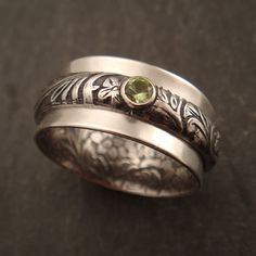 Pea Patch Spinner Ring by DownToTheWireDesigns on Etsy, $150.00 Love the secret garden inside the band