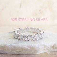 CZ Diamond Baguette wedding Band White gold sterling silver CZ diamonds 4 mm Sterling Silver ring unique eternity white gold wedding band by LasyaJewelry on Etsy https://www.etsy.com/listing/260229304/cz-diamond-baguette-wedding-band-white