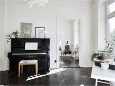 Dark wooden floors, whites and greys.