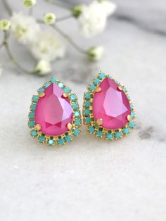 Pink Turquoise Earrings, Hot Pink Earrings, Fuchsia Studs Earrings, Swarovski Crystal Pink Earrings, Bridesmaids Pink Earrings, Pink Studs  These handmade Pear shape Swarovski Earrings 24k plated over brass are designed to make an impact set with pink fuchsia Crystal and finished with Turquoise small crystal halo An elegant way to finish day or evening looks sweep your hair to the side to showcase.  Petite Delights is an Official SWAROVSKI® Branding Partner Official Swarovski Elements®…