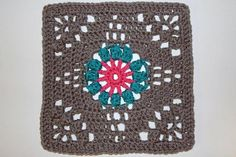 "Pattern: Crochet Floral Bouquet Afghan by Joyce Nordstrom Hook used: H Yarn Used: Hobby Lobby's I Love this Yarn Grey Beard, Peacock, and Hot Rose. Finished size: 8"" Every thing I love all in one square. A flower, lacy holes, and Popcorn stitches! I love this design. And the full..."