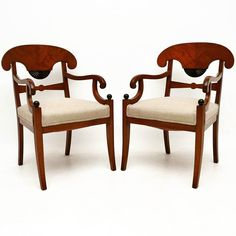 Pair of Antique Swedish Biedermeier Armchairs at Marylebone Antiques | This is a beautiful pair of antique Swedish Biedermeier armchairs with Trafalgar Backs & scroll over open arms. They also have some fine ebonised features like the fan shaped carvings & the small balls. These armchairs have very generous proportions & have front sabre legs. They have been just been imported from Sweden re-polished & re-upholstered in a neutral coloured fabric. They are in excellent condition throughout…