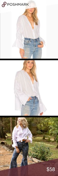 """Free People Browned Eyed Girl White Blouse Statement White Button-down Oversized boyfriend poplin Blouse with cuff dramatic sleeves.  Pair with Jeans , slacks , Leggings or a skirt.  Size small  Length 25"""" Bust 24"""" Sleeve 19"""" Free People Tops Button Down Shirts"""
