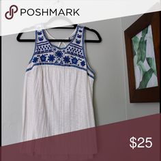 Jewel/scoop neck. White flow tank with blue detail Jewel/scoop neck with blue and black sewn on detailing. White, flowy tank top. Size is large, but can fit on girls who wear a size small, medium and large. Tags are not on it, but it has never been worn. American Eagle Outfitters Tops Blouses