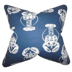 Bring a pop of style to your sofa or favorite reading nook with this eye-catching cotton pillow, showcasing a lobster motif in navy.