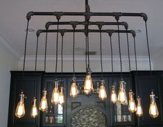 Items similar to Funky Edison Bulb, Pallet, and Pipe Chandelier on Etsy Edison Bulb Chandelier, Industrial Chandelier, Chandelier In Living Room, Metal Chandelier, Iron Chandeliers, Chandelier Lighting, Industrial Lighting, Industrial Design, Ceiling Light Fixtures