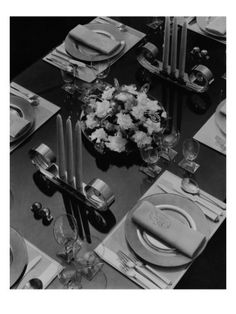Helen Hughes Dulany designed this place setting, which included Mosse embroidered linens, Mrs. Ehrich glasses and chromium candlesticks and centerpiece, for a story in the February 1934 House  Garden, photographed by Eugene Hutchinson.